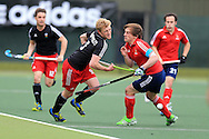 Rupert Shipperley of Wales (l)  is challenged by Hugo Genestet of France ®.  Mens international hockey, Wales v France at the National Hockey Centre, Sophia Gardens in Cardiff, South Wales on Thursday 21st April 2016.<br /> pic by Andrew Orchard, Andrew Orchard sports photography.