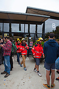 """Firemen at the Biblioteca Central Gabriel Ferrater, Sant Cugat del Valles, just outside Barcelona. Catalonia's firemen were joined by Basque firemen in a pledge to protect voters during the October 1st referendum on independence. Elsewhere in Catalonia, they were attacked by Spanish Guardian Civil and Policia Nacional. One of the firemen, Oriol said """"we just want to protect people"""".<br /> <br /> On October 1st 2017, Catalans voted in a binding referendum to decide whether the region should stay in Spain, or leave and become an independent Republic. The Madrid government of Mariano Rajoy sent thousands of extra police into Catalonia, brutally attacking around 10% of  voting centres and seizing ballot boxes, injuring nearly 1000 people in an effort to stop the vote. Despite the violence, there was turn turnout of well more than 42% with around 90% in favour of independence. Some 770,000 votes from an electorate of 5.5 million were stolen by police forces or unable to be cast  because of raids."""