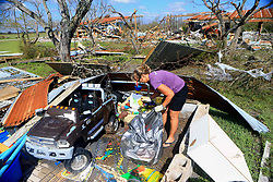 August 29, 2017 - Bayside, Texas, U.S. - SHERI GAGLIANO collects toys from a friend's house after Hurricane Harvey damaged the home on Tuesday. Harvey struck the Texas Coastal Bend as a Category 4 on Friday. (Credit Image: © Gabe Hernandez/TNS via ZUMA Wire)