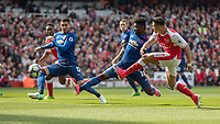 Football - 2016 / 2017 Premier League - Arsenal vs. Manchester United<br /> <br /> Alexis Sanchez of Arsenal gets his shot away ahead of the outstretched Axel Tuanzebe of Manchester United (making his debut) at The Emirates.<br /> <br /> COLORSPORT/DANIEL BEARHAM