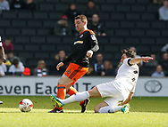 John Fleck of Sheffield Utd  fouled by Joe Walsh of MK Dons during the English League One match at  Stadium MK, Milton Keynes. Picture date: April 22nd 2017. Pic credit should read: Simon Bellis/Sportimage