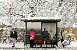 © under license to London News Pictures. 1.12.2010 Snow chaos in Orpington in Kent.  People waiting for a bus on Station Road, Orpington.. Picture credit should read Grant Falvey/London News Pictures