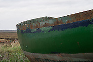 A disused boat hull sits in the saltmarsh at Tollesbury, England