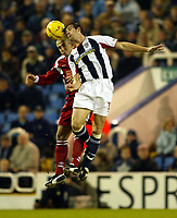 Photograph: Scott Heavey.<br /> West Bromwich Albion v Walsall. Nationwide Division One. 09/01/2004.<br /> Scott Dobie (L) beats Paul Ritchie in the air