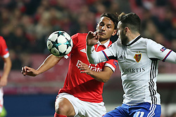 December 5, 2017 - Lisbon, Portugal - Benfica's Portuguese midfielder Joao Carvalho fights for the ball with Basel's midfielder Renato Steffen from Suisse (R ) during the UEFA Champions League Group A football match between SL Benfica and FC Basel at the Luz stadium in Lisbon, Portugal on December 5, 2017. Photo: Pedro Fiuza (Credit Image: © Pedro Fiuza via ZUMA Wire)