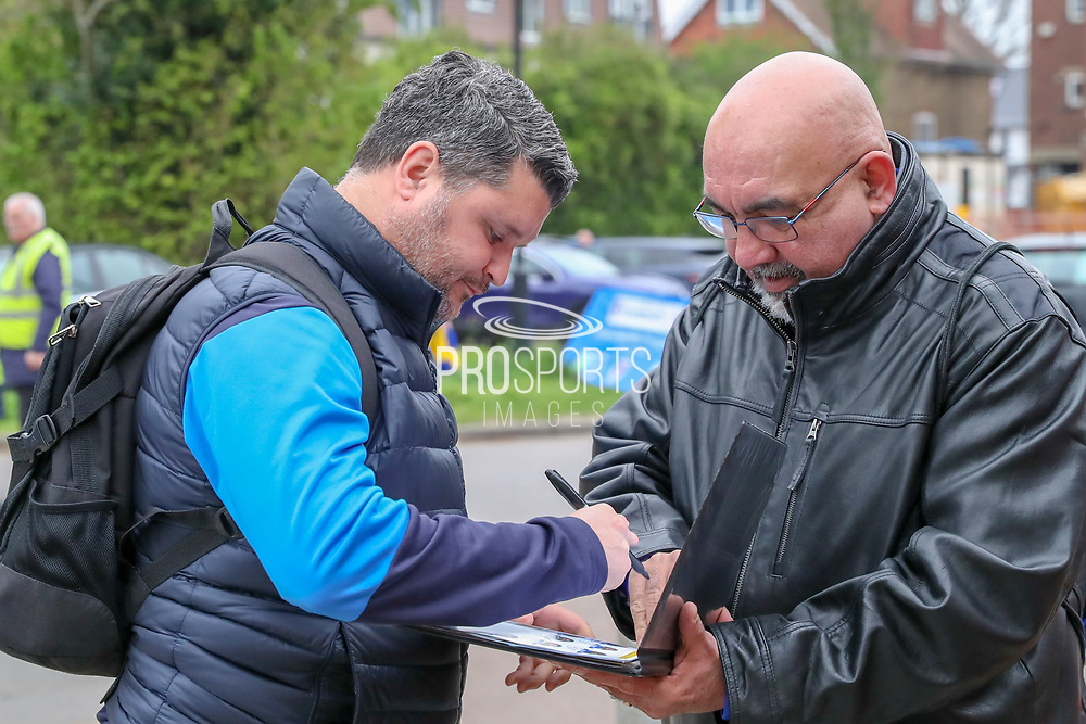 AFC Wimbledon coach Simon Bassey signing autographs during the EFL Sky Bet League 1 match between AFC Wimbledon and Accrington Stanley at the Cherry Red Records Stadium, Kingston, England on 6 April 2019.