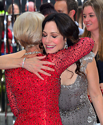 Red 2 UK film premiere.<br /> (L - R) Helen Mirren with Mary Louise Parker during the premiere of the sequel to 2010's graphic novel adaption, about a group of retired assassins. <br /> Empire Leicester Square<br /> London, United Kingdom<br /> Monday, 22nd July 2013<br /> Picture by Nils Jorgensen / i-Images