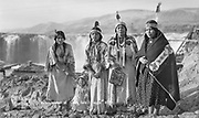 9305-B7348. Indian women in traditional dress at Celilo Falls. September 1938. 1= Agnes Thompson. 2= Louise Thompson. 3= Margaret Dick Buck (wife of Frank Buck), 4= Pee-up-sun-yai (wife of William Yallup), 5= Hannah Sohappy Yallup (wife of Tom Frank Yallup).