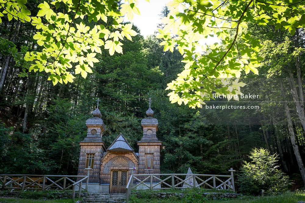 The wooden church (Ruska Capela) built by Russian Prisoners of War during WW1, in honour of their comrades who died building the Vrsic Pass road (Ruska Cesta) near kranjska Gora, on 22nd June 2018, in Triglav National Park, Julian Alps, Slovenia.