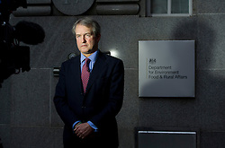 © London News Pictures. 09/02/2013 . London, UK.  Secretary of State for Environment, Food and Rural Affairs, OWEN PATERSON speaking to television outside the Department for the Environment, Food and Rural Affairs in London where he is due to meet  with representatives of the FSA, as well as food retailers and suppliers, to discuss the unfolding scandal over horsemeat being found in various products.. Photo credit : Ben Cawthra/LNP