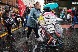 © Licensed to London News Pictures . 29/09/2019. Manchester, UK. Boris you're full of more crap than my sister's nappy placard on a pushchair . Thousands attend a march for the People's Assembly . Demonstrations for and against Brexit , austerity measures , the environment and numerous social issues take place across Manchester during the first day of the Conservative Party Conference taking place at the Manchester Central Exhibition Centre . Photo credit: Joel Goodman/LNP