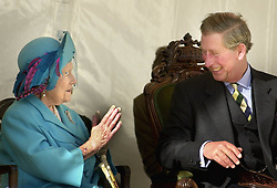 File photo dated 11/10/01 of the Queen Mother sharing a joke with her grandson the Prince of Wales, known as the Duke of Rothesay in Scotland, during the unveiling of an Aberdeen Angus sculpture at the Alford Transport Museum.