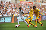 Pablo Hernandez of Swansea city breaks away from Gheorghe Grozav of Petrolul Ploiesti <br /> UEFA Europa league, play off round, 1st leg match, Swansea city v FC Petrolul Ploiesti at the Liberty stadium in Swansea on Thursday 22nd August 2013. pic by Phil Rees , Andrew Orchard sports photography,