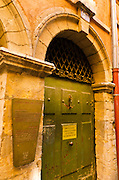 Sign and door at the Long Traboule (passageway) in old town Vieux Lyon, France (UNESCO World Heritage Site)