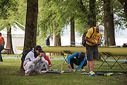 Varese. ITALY.    Members of the Chinese Team check over their equipment before a training outing at the 2015 FISA World Cup II Venue Lake Varese. Thursday  18/06/2015 [Mandatory Credit: Peter Spurrier/Intersport-images.com]