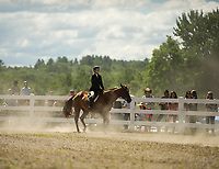 """Emily Maguire of Franklin leads her horse """"Cody"""" a Quarterhorse Arabian in the Senior Equitation competition at the Belknap County 4H Fair Saturday morning.  (Karen Bobotas/for the Laconia Daily Sun)"""