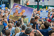 A cartoon/painting of a naked Farage and Boris being led over a cliff by a blind donkey - A march for Europe brings out thousands of remain supporters who march from Hyde Park to Parliament Square.