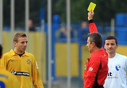 Ales Mertelj  gets yellow card from referee Andrej Tratnjek at 20. round of PrvaLiga Telekom Slovenije 2008/2009 match between NK Luka Koper and NK Hit Gorica, on December 6, 2008,  in Stadium Bonifika, Koper, Slovenia. Koper won 3:1.(Photo by Vid Ponikvar / Sportida)