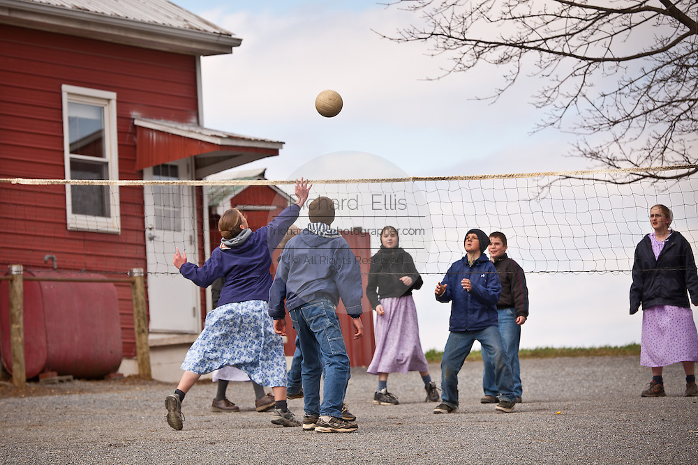 Amish children play volleyball at a one-room Amish schoolhouse,  PA