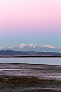 Earth's Shadow (the belt of venus) over Mount Blanshard (The Golden Ears) and Mount Robbie Reid. Photographed from Crescent Beach's Blackie Spit in Surrey, British Columbia, Canada