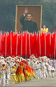 A float carrying a portrait of China's leader Deng Xiaoping, is marched through Tiananmen Square as China celebrates its 50th anniversary with a massive parade in Beijing October 1, 1999.