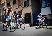 Three men ride their bicycles on the streets of Sopocachi district in La Paz. Since there were no cars or buses allowed to run on the streets, people took advantage to ride their bicycles, something that is almost unthinkable on a normal day. During elections period in  Bolivia, the country faces several restrictions, like no alcohol for sale 48 hours before and 12 after the election; no public gatherings, shows of any kind until the political parties made their speeches on the election night; its completely forbidden the circulation of any vehicles, private or governmental except with the permit from the Electoral Tribunal, which means it would be basically no cars, buses or anything circulating in the city; no long distance buses, the terminal will be close from Saturday until Monday and even flights will not be allowed except the ones leaving the country or the international ones doing stop-over. It is a completely shut down of the country.