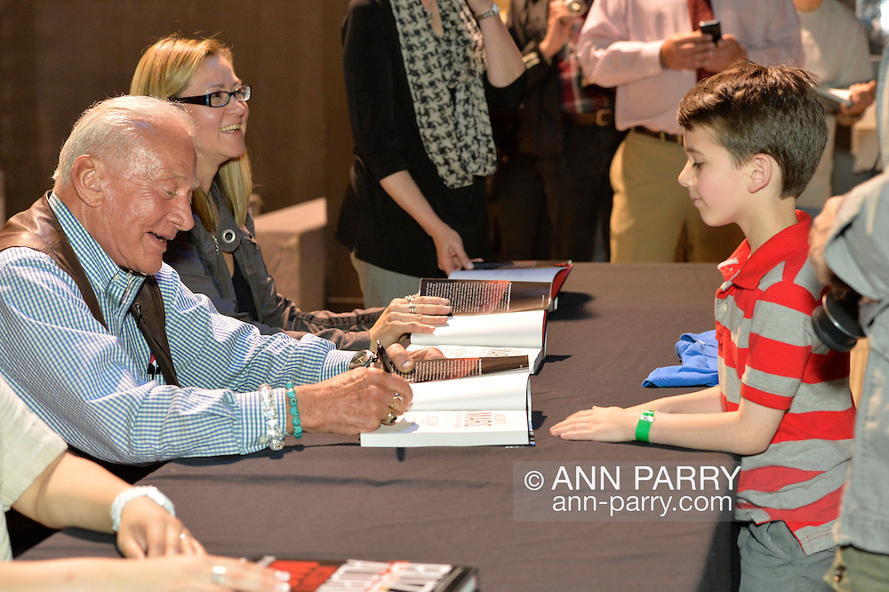 """May 11, 2013 - Garden City, New York U.S. - Astronaut BUZZ ALDRIN signs """"Mission to Mars"""" for KEATON COOKE, 6, of North Merrick at book signing at the Cradle of Aviation Museum.  The NASA astronaut engineer of Apollo 11 in 1969, was the second person to walk on the Moon."""