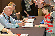 "May 11, 2013 - Garden City, New York U.S. - Astronaut BUZZ ALDRIN signs ""Mission to Mars"" for KEATON COOKE, 6, of North Merrick at book signing at the Cradle of Aviation Museum.  The NASA astronaut engineer of Apollo 11 in 1969, was the second person to walk on the Moon."