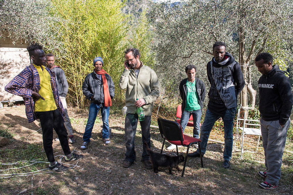 November 8, 2016 - Breil-sur-Roya, France: Cedric Herrou, a 37-year-old farmer, with some of the Eritrean migrants he houses on his farm. Cedric is one of the 120 inhabitants of the village Breil-sur-Roya in the Roya valley, in the Alps on the French Italian border, who formed a clandestine network to help migrants who walked into the valley from Ventimiglia, Italy, with shelter, food and transportation.<br /> <br /> 8 novembre 2016 - Breil-sur-Roya, France: Cedric Herrou, agriculteur de 37 ans, avec des migrants érythréens qu'il héberge dans sa ferme. Cédric est l'un des 120 habitants du village de Breil-sur-Roya dans la vallée de la Roya, à la frontière italienne, qui aident des migrants.