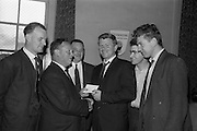 30/7/1964<br /> 7/30/1964<br /> 30 July 1964<br /> <br /> Mr. Martin Ryan (2nd from the left) the Senior Rep. from Beamish and Crawford presenting the Runners-Up Prize to Christopher Reid Captain of the McCafrey's team, watched by Peter McGylnn(3rd from the left) Dublin District Manager from Beamish and Crawford J Loftun(left) F. Millar(5th from left) and Mr Whelan (right) of the McCaffey's Dart room