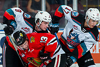 KELOWNA, BC - FEBRUARY 8: James Stefan #13 of the Portland Winterhawks checks Mark Liwiski #9 of the Kelowna Rockets after the puck drop in second period at Prospera Place on February 8, 2020 in Kelowna, Canada. (Photo by Marissa Baecker/Shoot the Breeze)