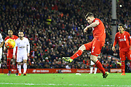 James Milner of Liverpool scores his teams 1st goal from the penalty spot. Barclays Premier League match, Liverpool v Swansea City at the Anfield stadium in Liverpool, Merseyside on Sunday 29th November 2015.<br /> pic by Chris Stading, Andrew Orchard sports photography.