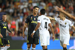 September 19, 2018 - Valencia, Spain - Cristiano Ronaldo of Juventus FC argues with Medhi Benatia of Valencia CF during the UEFA Champions League, Group H football match between Valencia CF and Juventus FC on September 19, 2018 at Mestalla stadium in Valencia, Spain (Credit Image: © Manuel Blondeau via ZUMA Wire)