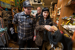 Shopping in the Mooneyes store during the Monday night afterparty at Mooneyes Area One after the Mooneyes Yokohama Hot Rod & Custom Show. Yokohama, Japan. December 5, 2016.  Photography ©2016 Michael Lichter.