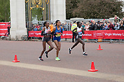 Elite women runners, Roza Dereje, from Ethiopia, Gladys Cherono and Mary Keitany from Kenya, running on The Mall during the Virgin London Marathon on 28th April 2019 in London in the United Kingdom. Now in it's 39th year, the London Marathon is a large sporting event with over 40,000 runners expected to take part.