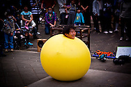 A performer inside a large yellow balloon in Ueno Park, Tokyo, Japan.