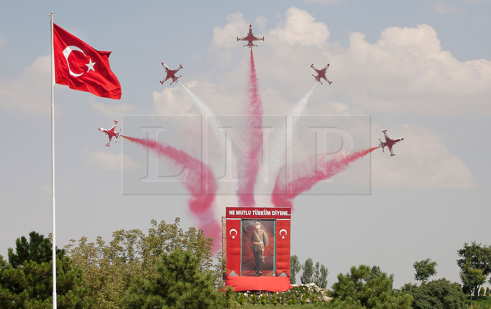 © licensed to London News Pictures. ANKARA, TURKEY  30/08/11. The Turkish Stars, air acrobatics team, performing a show at the 30th August Turkish Victory Day celebrations in capital Ankara. The Turkish Stars is one of the eight air acrobatics teams which flight with supersonic jets. Please see special instructions for usage rates. Photo credit should read TOLGA AKMEN/LNP