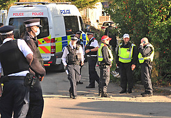©Licensed to London News Pictures 09/09/2020  <br /> Orpington, UK. Police on the site. Armed police have raided a travellers site in Orpington, South East London. Several hundred officers raided the site in the middle of the night and arrested people believed to be involved in supplying criminal gangs with firearms. Photo credit:LNP