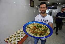 June 6, 2017 - Gaza City, Gaza Strip, Palestinian Territory - A Palestinian vendor prepares chickpeas known as ''Hummus'' for breakfasting on the Muslim holy fasting month of Ramadan in Gaza city, on June 03, 2017. Ramadan is sacred to Muslims because it is during that month that tradition says the Koran was revealed to the Prophet Mohammed. The fast is one of the five main religious obligations under Islam. More than 1.5 billion Muslims around the world will mark the month, during which believers abstain from eating, drinking, smoking and having sex from dawn until sunset  (Credit Image: © Mohammed Asad/APA Images via ZUMA Wire)