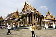 Tourists photograph the Royal Temple of the Emerald Buddha,Wat Phra Keow and Salarai, Bangkok, Thailand