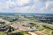 Nederland, Noord-Brabant, Gemeente Den Bosch, 26-06-2014;  aanleg Maximakanaal, directe verbinding tussen de Maas en de Zuid-Willemsvaart. Knooppunt Hintham, A2 - A59.<br /> Door de omlegging van Zuid-Willemsvaart hoeft de beroepsvaart niet langer door de binnenstad van Den Bosch. Ook maakt het nieuwe kanaal het mogelijk met grotere schepen te varen.<br /> Construction Maxima channel, direct connection between river Meuse river and the South Willemsvaart, East of Den Bosch. <br /> luchtfoto (toeslag op standaard tarieven);<br /> aerial photo (additional fee required);<br /> copyright foto/photo Siebe Swart.