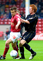 Photo: Dave Linney.<br />Walsall v Milton Keynes Dons. Coca Cola League 1.<br />08/10/2005. Joe Broad keeps hold of the ball despite the close attention  of Dean Lewington/MK Dons
