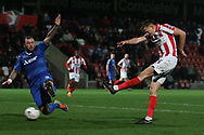 Danny Kedwell blocks a Will Boyle shot during the The FA Cup 1st round replay match between Cheltenham Town and Ebbsfleet at LCI Rail Stadium, Cheltenham, England on 20 November 2018.