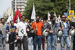May 1, 2019 - Thessaloniki, Greece - People hold flags as they march during a rally organized by the Communist-affiliated PAME labor union. Hundreds of people gathered at the center of Thessaloniki and took part at May Day demonstrations. (Credit Image: © Giannis Papanikos/ZUMA Wire)