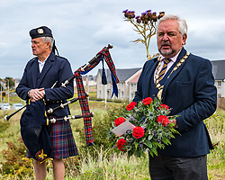 Musselburgh, East Lothian, Scotland, UK, Battle of Pinkie Cleugh commemoration: the annual ceremony takes place in a new format with live streaming as well as actual participation. The 473rd anniversary of the significant battle in Scotland's 'Rough Wooing' history is marked by a battle trail walk organised by the Pinkie Cleugh Battlefield Group ending at the memorial stone and a minute's silence for the 10,000 Scots killed on a day known as 'Boody Saturday'.  The battle was the largest ever fought in Scotland and resulted in a defeat for the Scots. Pictured: Colin Pryde, piper and John McMillan, Porvost of East Lothian.<br /> Sally Anderson   EdinburghElitemedia.co.uk
