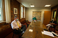 Chris Kelly of Bayside Realty sits with Joe Adrignola and Margaret Demos to discuss putting the Busiel Mill on the sales market Tuesday morning.  (Karen Bobotas/for the Laconia Daily Sun)