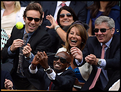 Mo Farah attempts to catch a tennis ball from Centre Court, while sitting in the Royal Box, With Michael and Carole Middleton, the parents of The Duchess of Cambridge and actor Alessandro Nivola on Day 3 of The Wimbledon Lawn Tennis Championships,<br /> Wimbledon, London, United Kingdom<br /> Wednesday, 26th June 2013<br /> Picture by Andrew Parsons / i-Images