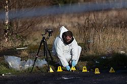 © Licensed to London News Pictures . 29/12/2018 . Wigan , UK . A forensic scenes of crime examiner at the scene where police have taped off a stretch of Bickershaw Lane in Abram . GMP report they have arrested two people on suspicion of attempted murder and for conspiracy to commit attempted murder , respectively , after a 21-year-old man sustained life-threatening injuries yesterday evening (Friday 28th December 2018) . Photo credit : Joel Goodman/LNP