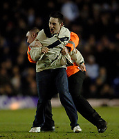 Photo: Glyn Thomas.<br />Birmingham City v Liverpool. The FA Cup. 21/03/2006.<br /> A fan invades the pitch, but is tackled by stewards.