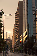 Buildings and streetlights on city street at sunset, Santiago, Chile